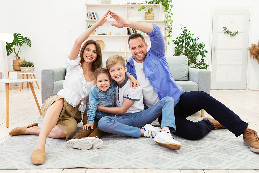 A happy family sitting in their new apartment living room